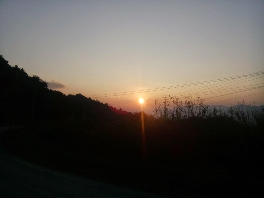 sun setting over mountain