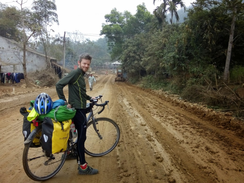 Man in bike on a muddy road