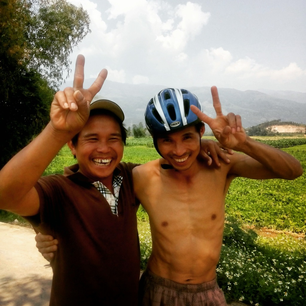 two men making the peace sign