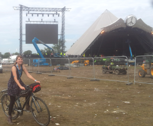 Girl on bike in front of Pyramid Stage