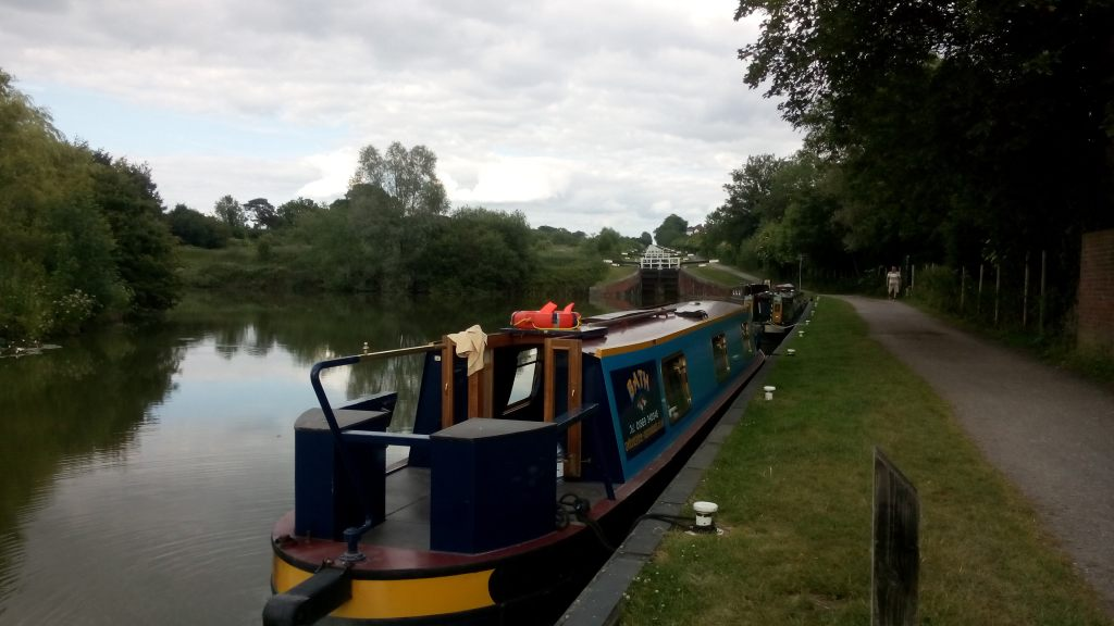 Canal boat with lock gates 'staircase' in background